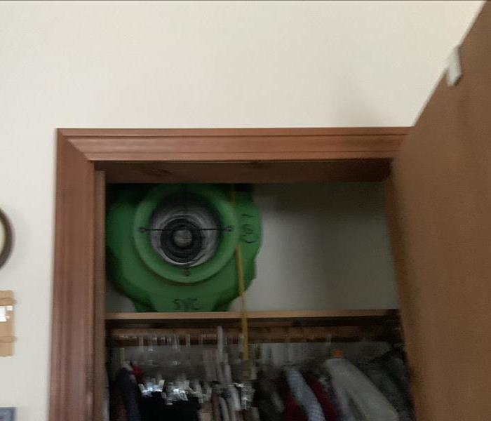 Fan placed in the closet for drying purposes.