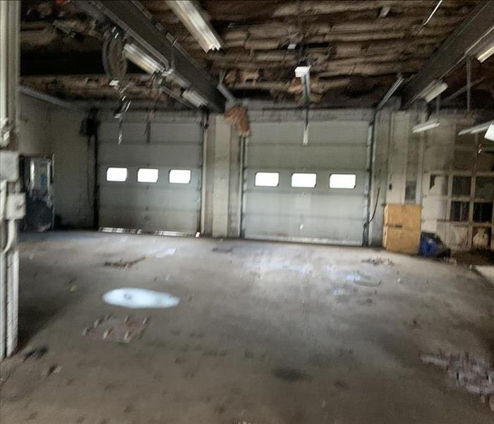 Empty commercial building before cleanup.
